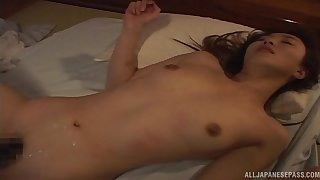 Japanese wife with natural tits gets a body cumshot on the bed